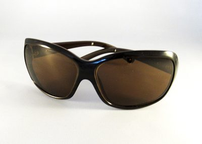 Specially worked single vision tinted lenses in a Prada frame.