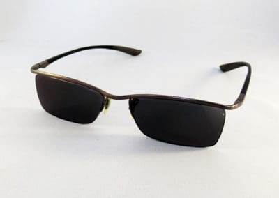 Tailor Made XtrActive Transitions grey in a RayBan frame.