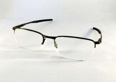 Freeform 1.6 anti-reflection lenses into an Oakley half-rim.