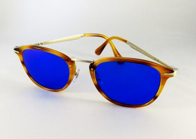 Blue tint and mirror coated lenses to a Persol Italian hand made frame.