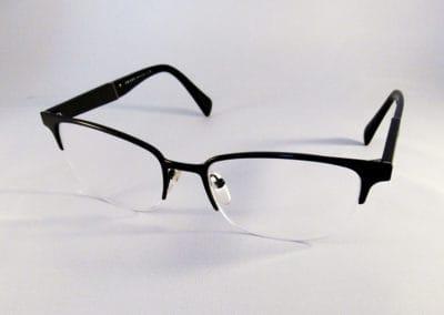 Single vision 1.4 antireflective in a Prada semi rim.