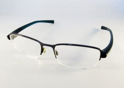 Essentials varifocal lenses into a Nike half rim frame.