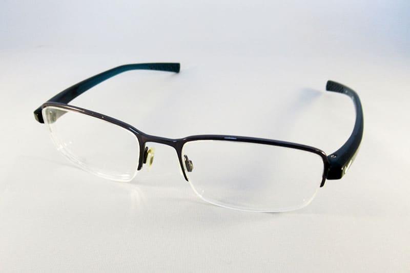 1cbcd48a20a Essentials varifocal lenses into a Nike half rim frame.