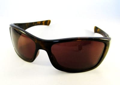Single vision 1.5 specially worked tinted lenses into an Oakley Hijinx wrap.