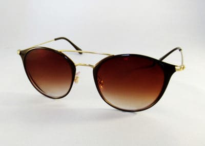 Single vision 1.5 graduated brown tints in a Ray-Ban frame.