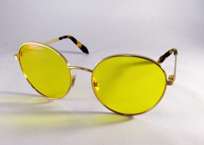 Tailor Made varifocals with a yellow tint in a Victoria Beckham frame.